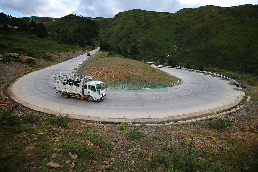 August 22, 2017 - China - Sichuan, CHINA-20th August 2017: (EDITORIAL USE ONLY. CHINA OUT) ..The winding mountain road with altitude of 4,000 meters is located in southwest China's Sichuan Province. (Credit Image: © SIPA Asia via ZUMA Wire)