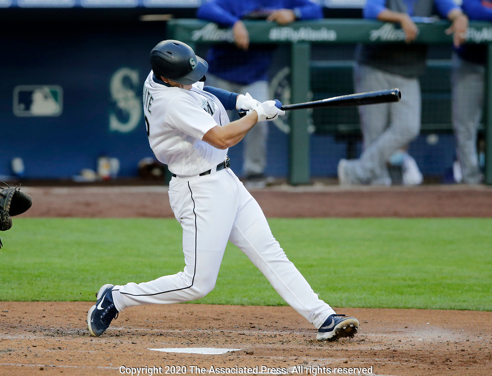 Seattle Mariners's Evan White hits a three-run home run on a pitch from Texas Rangers Jordan Lyles during the third inning of a baseball game, Saturday, Aug. 22, 2020, in Seattle. (AP Photo/John Froschauer)