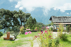Traditional house in Nepal with Himalayas mountain in background