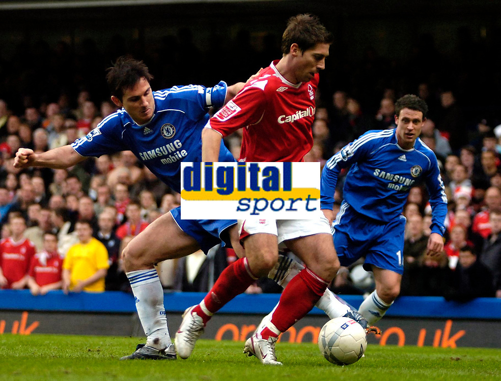 Photo: Ed Godden/Sportsbeat Images.<br /> Chelsea v Nottingham Forest. The FA Cup. 28/01/2007.<br /> Forest's Nicky Southall is tackled from behind by Frank Lampard (L).