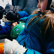 Jade (foreground) and Micah Goodrich mess around on the bus ride back to the parking lot at Jackson Hole Mountain Resort in Teton Village, Wyoming.