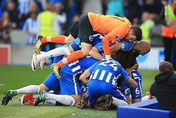15 October 2017 -  Premier League - Brighton and Hove Albion v Everton - Anthony Knockaert of Brighton and Hove Albion smothered by team mates celebrates scoring the opening goal - Photo: Marc Atkins/Offside