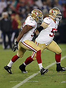 San Francisco 49ers defensive end Ronald Blair (98) and San Francisco 49ers linebacker Shayne Skov (56) rush the quarterback during the 2016 NFL preseason football game against the San Diego Chargers on Thursday, Sept. 1, 2016 in San Diego. The 49ers won the game 31-21. (©Paul Anthony Spinelli)