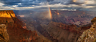 Rainbow and spot lighting in the Grand Canyon in the early morning following a storm, from Lipan Point.(This is a large file suitable for very large prints.) © David A. Ponton