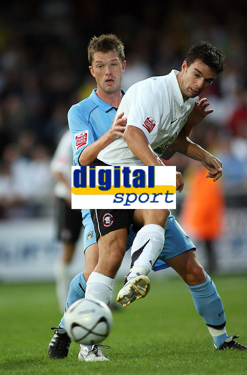 Photo: Rich Eaton.<br /> <br /> Hereford United v Coventry City. Carling Cup. 22/08/2006. Herefords Tim Sills plays the ball as Coventrys Stephen HUghes tries to tackle