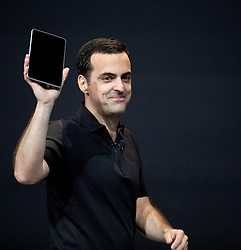 Hugo Barra, product management director of Android, holds up a Nexus 7 tablet  at the annual Google I/O developers conference in San Francisco, California.