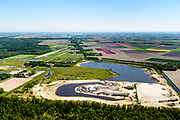Nederland, Flevoland, Noordoostpolder, Bant, 07-05-2018; De Kuilen of de Veenkuil, oorspronkelijk veenplas, onderdeel van de zeebodem, nu ook zandwinning. <br /> Gelegen bij Kuinderbos.<br /> De Kuilen or Veenkuil, originally peat pit, part of the seabed, now also sand extraction<br /> luchtfoto (toeslag op standard tarieven);<br /> aerial photo (additional fee required);<br /> copyright foto/photo Siebe Swart