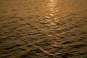 Golden sunset refection on water