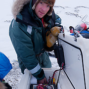 BJ Kirschhoffer working on the insides of the cooler that holds the remote camera. Svalbard, Norway