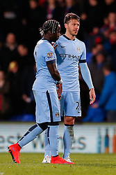 Bacary Sagna and Martin Demichelis of Manchester City looks dejected after Crystal Palace win the match 2-1 - Photo mandatory by-line: Rogan Thomson/JMP - 07966 386802 - 06/04/2015 - SPORT - FOOTBALL - London, England - Selhurst Park - Crystal Palace v Manchester City - Barclays Premier League.