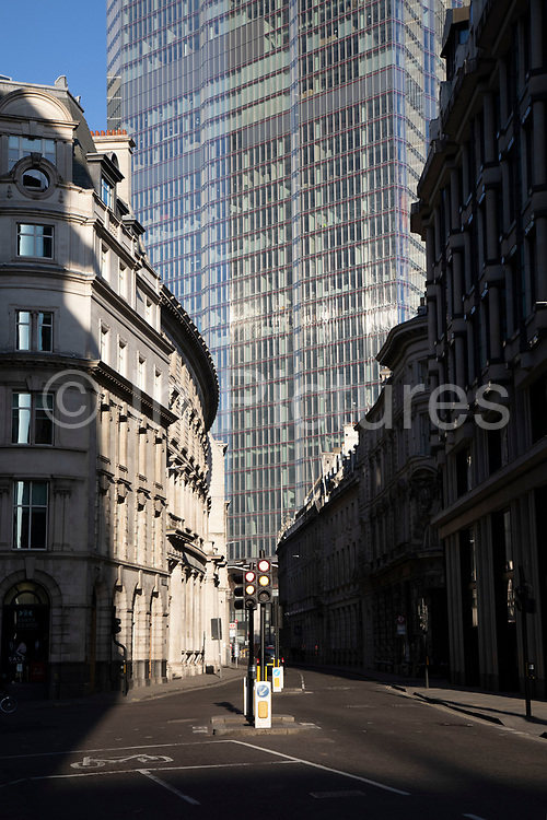 Rush hour in the City of London financial district is virtually deserted due to the Coronavirus outbreak on 23rd March 2020 in London, England, United Kingdom. Following government advice city workers are staying at home to work leaving the streets quiet, empty and eerie. Coronavirus or Covid-19 is a new respiratory illness that has not previously been seen in humans. While much or Europe has been placed into lockdown, the UK government has announced more stringent rules as part of their long term strategy, and in particular social distancing.