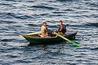 Egypt. Cruising the Nile from Kom Ombo to Luxor, passing Edfu and Esna. Fishermen at the Nile.