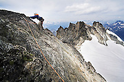 Climber Brian Polagye ascends the thin Northwest ridge of Dorado Needle, a rocky spire in the heart of North Cascades National Park, Washington on August 11, 2007.