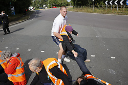 © Licensed to London News Pictures. 29/09/2021. Swanley, UK. An angry motorists drags an activist from the Insulate Britain climate change protest group as they block the road near to junction 3 of the M25 motorway near Swanley for the second time today. 11 members of the campaign group were detained at the same junction earlier today. This is the seventh time in just over two weeks that activists have disrupted traffic on London's orbital motorway despite the government being granted a temporary High Court Injucntion banning the group from protesting on the M25. 50 protesters who were detained after Monday's protest, on junction 14 of the M25 at Heathrow, were released. Photo credit: Peter Macdiarmid/LNP