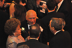 Carm Cozza along with his wife mingling with Yale President Rick Levin and others. Yale University Department of Athletics Blue Leadership Ball 2009. Formal Dinner at the Lanman Center, Presentation of Awards to Blue Leader Honorees and Speeches.