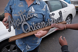 August 16, 2018 - Detroit, Michigan, U.S. - JAMES CHAPMAN JR. of Romulus holds a metal sign he made while stopping by New Bethel Baptist Church in Detroit while visiting the church where Aretha Franklin grew up attending in Detroit on Thursday, following her passing. (Credit Image: © Ryan Garza/Detroit Free Press via ZUMA Wire)