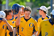 OFallon teammates surround Connor Lindsey (7, center) to congratulate him at the plate after he hit a solo home run. OFallon played Joliet West in a Class 4A baseball sectional championship game at Blazier Field in OFallon, IL on Friday June 11, 2021. Tim Vizer/Special to STLhighschoolsports.com.