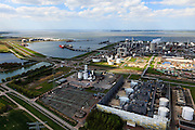 Nederland, Zeeland, Terneuzen, 09-05-2013; Zeeuws-Vlaanderen, Terneuzen. Zicht op de Westerschelde met aan de andere oever Zuid-Beveland.  <br /> Site van de chemische fabriek van Dow (Dow Chemical Company) aan de Westerschelde. De kraakinstallaties maken o.a. benzeen, ethyleen en propyleen (basischemicalien voor halffabrikaten voor verschillende kunststoffen).<br /> Zeeuws-Vlaanderen,  the south-west part of the province of Zeeland site of the chemical plant of Dow Chemical Company. This plant produces benzene, ethylene and propylene, the basis for various plastics. View on the Westerschelde.<br /> luchtfoto (toeslag op standard tarieven);<br /> aerial photo (additional fee required);<br /> copyright foto/photo Siebe Swart.