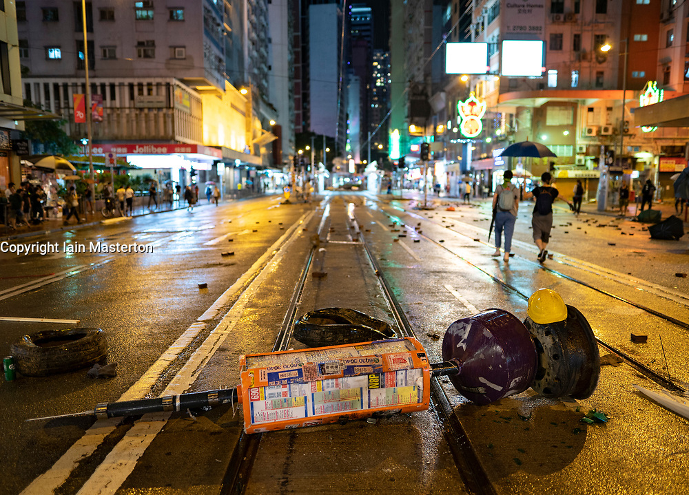 Hong Kong. 6 October 2019. Tens of thousands of pro-democracy protestors march in pouring rain through centre of Hong Kong today from Causeway Bay to Central. Peaceful march later turned violent as a hard-core of protestors confronted police. Pic; Barricade on street in Wanchai district. Iain Masterton/Alamy Live News.