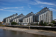 Modern apartment buildings on the Thames at Wandsworth, London. Building along the river has increased in the last 10 years, with ever more modern contruction being the norm.