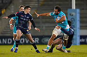 Sale Sharks flanker Tom Curry tackles Warriors No.8 Marco Mama during the Gallagher Premiership match Sale Sharks -V- Worcester Warriors at The AJ Bell Stadium, Greater Manchester,England United Kingdom, Friday, January 08, 2021. (Steve Flynn/Image of Sport)