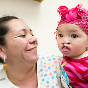 CAPTION: Because Marie was found to have some allergies, she is being observed by the Cleft Clinic's immunologist paediatrician. The doctors are hoping that they will be able to perform her next surgery in four weeks' time, closing the cleft on the other side. LOCATION: Hospital Escuela, Tegucigalpa, Honduras. INDIVIDUAL(S) PHOTOGRAPHED: Teresa Moreno Ramero (left) and Marie Jose Martinez Romero (right).