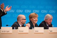 09 DEC 2014, KOELN/GERMANY:<br /> Peter Tauber (L), CDU Generalsekretaer, Angela Merkel (M), CDU, Bundeskanzlerin, und Volker Bouffier (R), CDU, Ministerpraesident Hessen, Merkel nimmt nach Ihrere Rede den Applaus der Delegierten entgegen, CDU Bundesparteitag, Messe Koeln<br /> IMAGE: 20141209-01-054<br /> KEYWORDS: Party Congress, applaudieren, klatschen