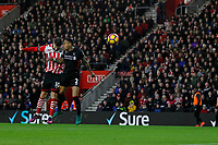 Football - 2016 / 2017 Premier League - Southampton vs. Liverpool<br /> <br /> Southampton's Charlie Austin climbs above Nathaniel Clyne of Liverpool to head narrowly wide at St Mary's Stadium Southampton England<br /> <br /> COLORSPORT/SHAUN BOGGUST