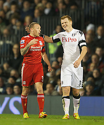 05.12.2011, Craven Cottage Stadion, London, ENG, PL, FC Fulham vs FC Liverpool, 14. Spieltag, im Bild Liverpool's Craig Bellamy in action against Fulham's John Arne Riise during the football match of English premier league, 14th round, between FC Fulham and FC Liverpool at Craven Cottage Stadium, London, United Kingdom on 05/12/2011. EXPA Pictures © 2011, PhotoCredit: EXPA/ Sportida/ David Rawcliff..***** ATTENTION - OUT OF ENG, GBR, UK *****