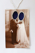 vintage wedding photograph with medallion over the faces of the portrait