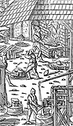 Smelting iron, A, and hammering bars with a mechanical hammer. From Agricola 'De re metallica' Basle 1556. Woodcut