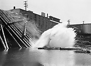 9969-4446. Logs being dumped from a truck into the Willamette River at Oregon City. September 7, 1939.