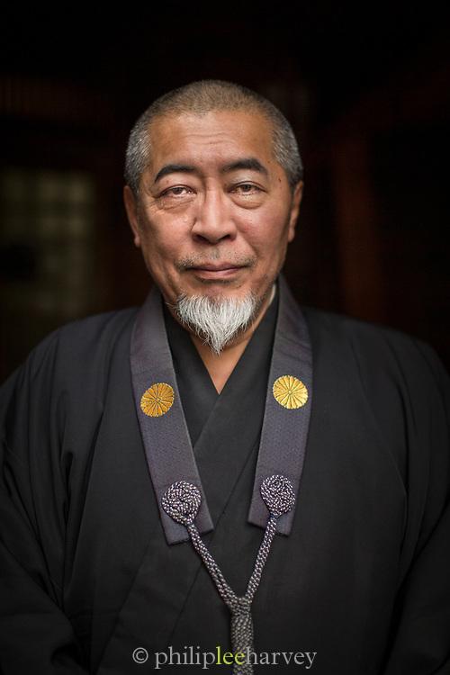 Portrait of monk looking at camera, Nagano, Japan