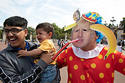 Anti Brexit protester dressed up as a clown version of Prime Minister Boris Johnson hires a Boris bike in Westminster and cycles to Buckingham Palace although makes a young tourist cry as it is announced that Boris Johnson has had his request to suspend Parliament approved by the Queen on 28th August 2019 in London, England, United Kingdom. The announcement of a suspension of Parliament for approximately five weeks ahead of Brexit has enraged Remain supporters who suggest this is a sinister plan to stop the debate concerning a potential No Deal.