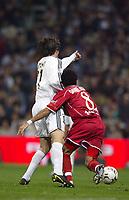 4/2/2004 Madrid, Spain.<br />Copa Del Rey (Spanish Cup) Semifinals. 1 Leg.<br />R.Madrid 2 - Sevilla 0<br />R.Madrid's Solari in duel with Sevilla's Daniel Alves at Santiago Bernabeu's Stadium.