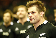 Picture by Andrew Tobin/SLIK images +44 7710 761829. 2nd December 2012. Richie McCaw watches England celebrate victory after the QBE Internationals match between England and the New Zealand All Blacks at Twickenham Stadium, London, England. England won the game 38-21.