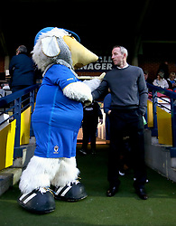 Charlton Athletic caretaker manager Lee Bowyer shakes hands with the AFC Wimbledon mascot before the game begins