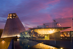 """Museum of Glass at sunset, with cone of """"hot shop"""" and reflecting pool, Tacoma, WA, USA"""