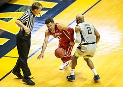 Jan 6, 2018; Morgantown, WV, USA; Oklahoma Sooners guard Trae Young (11) dribbles the ball and is guarded by West Virginia Mountaineers guard Jevon Carter (2) during the first half  at WVU Coliseum. Mandatory Credit: Ben Queen-USA TODAY Sports