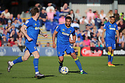 AFC Wimbledon midfielder Tom Soares (14) dribbling and starting an attack during the EFL Sky Bet League 1 match between AFC Wimbledon and Southend United at the Cherry Red Records Stadium, Kingston, England on 25 March 2017. Photo by Matthew Redman.