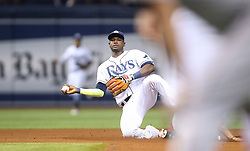 August 8, 2017 - St. Petersburg, Florida, U.S. - WILL VRAGOVIC   |   Times.Tampa Bay Rays shortstop Adeiny Hechavarria (11) with nowhere to throw on the fielder's choice by Boston Red Sox third baseman Rafael Devers (11), second baseman Dustin Pedroia (15) scored, in the fourth inning of the game between the Boston Red Sox and the Tampa Bay Rays at Tropicana Field in St. Petersburg, Fla. on Tuesday, August 8, 2017. (Credit Image: © Will Vragovic/Tampa Bay Times via ZUMA Wire)