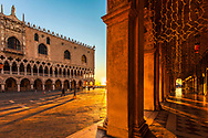 Red columns of Marciana library at sunrise in Venice