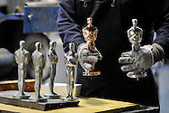 A worker prepares Oscar Statuette for polishing at the R. S. Owens manufacturing facility on February 9, 2012 in Chicago. The company has been manufacturing the award since 1983 when the previous supplier ceased operations.  (UPI)