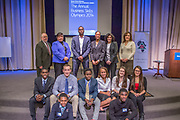 Purchase, NY – 31 October 2014. Second place winners from Woodlands High School with the judges behind them. (Front row, left to right: Miles Jackson, Christopher Larrow; second row: Akibo Watson, Kyle Smith, Awa  Nymabi, Jillian Berridge, Alex Jarmatz, Kaltrina Celaj.) The Business Skills Olympics was founded by the African American Men of Westchester, is sponsored and facilitated by Morgan Stanley, and is open to high school teams in Westchester County.