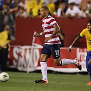 Jermaine Jones, USA, tracked by Neymar, Brazil, during the USA V Brazil International friendly soccer match at FedEx Field, Washington DC, USA. 30th May 2012. Photo Tim Clayton