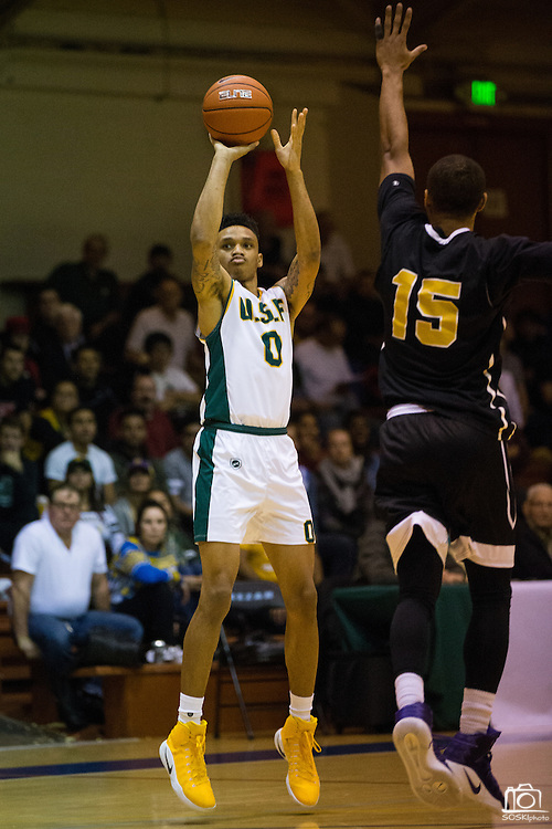 San Francisco Dons guard Marquill Smith (0) shoots a jumper against the San Francisco State University Gators at Kezar Pavilion in San Francisco, Calif., on December 6, 2016. (Stan Olszewski/Special to S.F. Examiner)