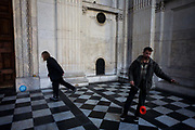 Anti-capitlaist activists play fotballball and juggle a diabolo on tiled flooring  of the Sir Christopher Wren-designed St Paul's Cathedral on the 11th day of the Occupy London protest camp in its churchyard, London 26/11/11. Forced to close for the first time since the 2nd world war, due to health and safety concerns, preventing services City lawyers are using medieval pedestrian bylaws to gain a court injunction to evict the activists who set up tents and shelters.
