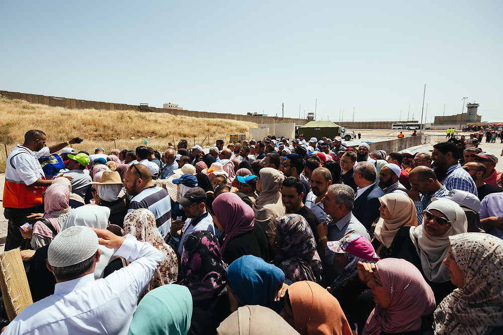 Palestinians queue to board buses headed to Jerusalem after crossing Qalandiya checkpoint, south of Ramallah, West Bank, on May 17, 2019, on their way to perform the second Friday Prayer of the Muslim holy month of Ramadan, at the Al Aqsa Mosque in Jerusalem. Israeli authorities are introducing biometric border crossing systems at West Bank checkpoints, thus minimizing the interaction between Israeli soldiers and Palestinians crossing into Israel.