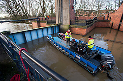 © Licensed to London News Pictures. 29/12/2015. York, UK. Members of the environment agency examine the Foss Barrier while it is closed in York city centre. Several warnings of risk to life are sill in place in parts of Lancashire and Yorkshire where rainfall has been unusually high, causing heavy flooding. Photo credit: Ben Cawthra/LNP