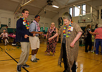 Matt Swormstedt, Pan Pradachith, Sharon Morningstar-Leonard and Ann Emerson hit the dance floor at the Laconia Community Center during Laconia High School's Hawaiian themed Senior/Senior prom Thursday evening.  (Karen Bobotas/for the Laconia Daily Sun)